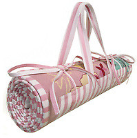 pink and white striped beach mat