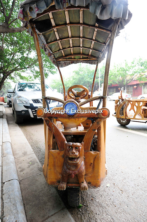 LIUZHOU, CHINA - MAY 19: (CHINA OUT) <br /> <br /> Wooden Three-wheeled Vehicle<br /> <br /> Wei Guirongs first home-made three-wheeled vehicle is seen on May 19, 2014 in Liuzhou, Guangxi Province of China. Wei Guirong, 66, has made three wooden three-wheeled vehicles for grandchildren, and the vehicles are made entirely from wood, apart from the engine, wheels and some electronic parts. He was in charge of maintaining agricultural machinery when he was younger. <br /> &copy;Exclusivepix