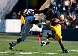 October 24, 2009; Berkeley, CA, USA;  California Golden Bears running back Shane Vereen (34) delivers a stiff arm to Washington State Cougars safety Chima Nwachukwu (21) during the fourth quarter at Memorial Stadium.  California won 49-17.