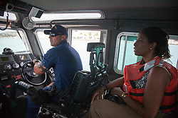 BM1 Chris Fingleman pilots the SPC-LE with Congresswoman Stacey Plaskett.   Coast Guard Boat Forces in the US Virgin Islands unveil two of the four 33-Special Purpose Craft Law-Enforcement (SPC-LEs) Boats that will be stationed in St. Thomas.   The SPC-LE's are specially built for counter-drug and migrant missions while patroling the border.  © Aisha-Zakiya Boyd