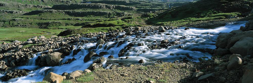 River running into fiord Mj&oacute;ifj&ouml;r&eth;ur in East Iceland. &Aacute; rennur &iacute; Mj&oacute;afj&ouml;r&eth; &aacute; Austfj&ouml;r&eth;um.<br />