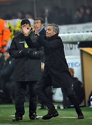 Jose Mourinho checks out his dance moves during the Serie A match between Inter Milan and AC Milan at Stadio Giuseppe Meazza on January 24, 2010 in Milan, Italy.