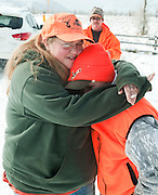 PRICE CHAMBERS / NEWS&amp;GUIDE<br /> Tanya Allison hugs her nephew Tucker Allison, 11, on Sunday after hunting elk in Grand Teton National Park. Their group from Gillette shot several elk after a snow storm pushed the animals into the hunt area.