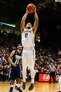 November 16th, 2013:  Colorado Buffaloes junior guard Askia Booker (0) floats up for a baseline shot in the first half of action in the NCAA Basketball game between the Jackson State Tigers and the University of Colorado Buffaloes at the Coors Events Center in Boulder, Colorado