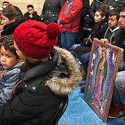 The Feast Our Lady of Guadalupe celebration annual two-day feast celebration of Mexico's patron saint. Braving extremely cold temperatures, believers from the Chicago area and other parts of the United States gather day and night to pray and pay homage at the shrine. Photography by Jose More