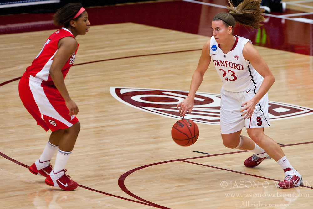 March 21, 2011; Stanford, CA, USA; Stanford Cardinal guard Jeanette Pohlen (23) dribbles past St. John's Red Storm guard Nadirah McKenith (5) during the first half of the second round of the 2011 NCAA women's basketball tournament at Maples Pavilion. Stanford defeated St. John's 75-49.