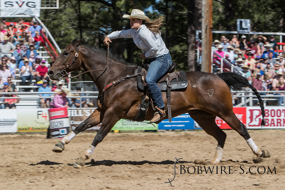 Haley Scheer makes her barrel racing run in the first performance of the Elizabeth Stampede on Saturday, June 2, 2018.