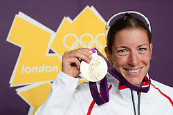 04.08.2012, Hyde Park, London, GBR, Olympia 2012, Triathlon Damen, im Bild Olympiasiegerin Nicola Spirig (SUI) mit der Goldmedaille // during Triahtlon Women, at the 2012 Summer Olympics at the Hyde Park, London, United Kingdom on 2012/08/04. EXPA Pictures © 2012, PhotoCredit: EXPA/ Freshfocus/ Valeriano Di Domenico..***** ATTENTION - for AUT, SLO, CRO, SRB, BIH only *****