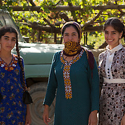 A mother and daughters in the courtyard of their family home, Nokhur village, Turkmenistan