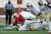 DALLAS, TX - DECEMBER 7: Kevin Pope #3 of the SMU Mustangs is brought down by the Central Florida Knights on December 7, 2013 at Gerald J. Ford Stadium in Dallas, Texas.  (Photo by Cooper Neill) *** Local Caption *** Kevin Pope