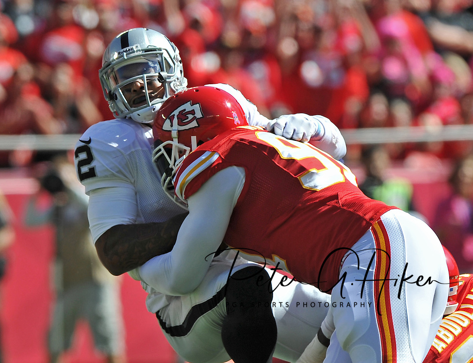 KANSAS CITY, MO - OCTOBER 13:  Linebacker Tamba Hali #91 of the Kansas City Chiefs sacks quarterback Terrelle Pryor #2 of the Oakland Raiders during the first half on October 13, 2013 at Arrowhead Stadium in Kansas City, Missouri.  (Photo by Peter Aiken/Getty Images) *** Local Caption *** Tamba Hali;Terrelle Pryor