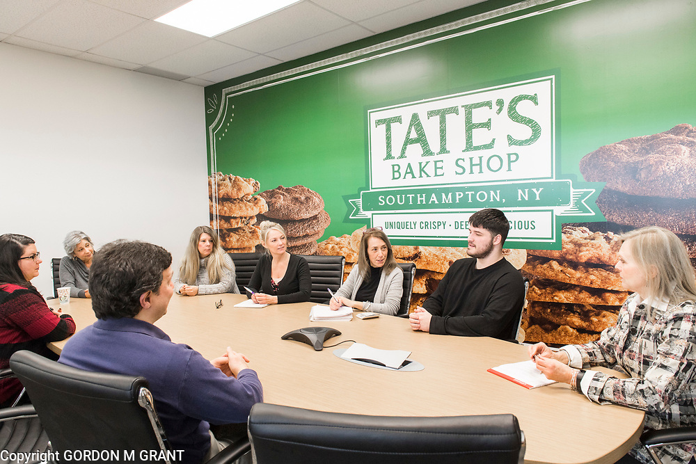 Tate's Bake Shop CEO, Maura Mottolese, center, holds a meeting in a conference room at the companies distribution center at the Hampton Business District at Gabreski Airport in Westhampton, Jan. 16, 2018. Tate's Bake Shop is expanding it's distribution facility into a newly constructed building at the site.