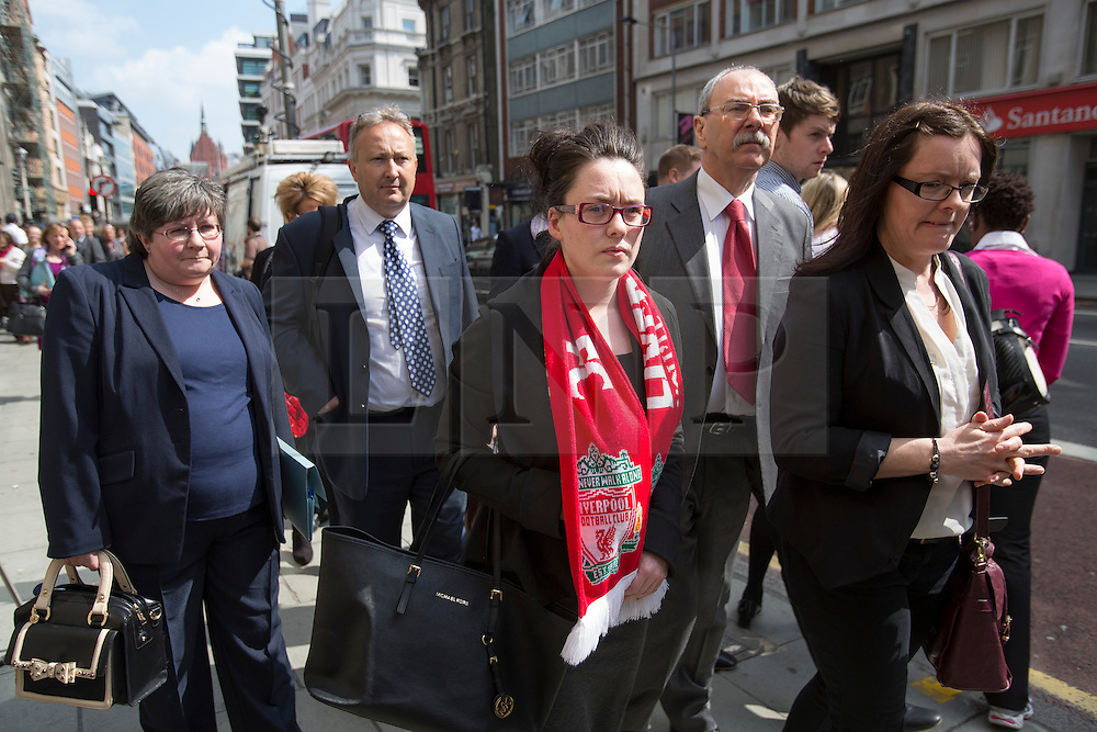 © licensed to London News Pictures. London, UK 25/04/2013. Families of the 96 football fans who lost their lives in the Hillsborough disaster attending to a pre-inquest at the Family Division of the High Court in London on Thursday, 25 April 2013. A hearing to decide the date and location of a new inquest into the 96 people who died in the Hillsborough disaster has begun in London. Photo credit: Tolga Akmen/LNP