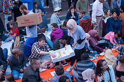 © Licensed to London News Pictures. 07/06/2018. Bristol, UK. Grand Iftar Ramadan celebration meal. One of the biggest street parties in the UK is held in Bristol and everyone and anyone is invited. Over 1000 people attended Easton Jamia Mosque's Grand Iftar celebration in St Marks Road, organised to give the the local Muslim community the opportunity break bread with their wider community during Ramadan. Festivities included a feast with food handed out to everyone by the muslim community, as well as an opportunity to meet people from all walks of life. Similar events across the country are held to promote and celebrate unity within the community, giving people the chance to come along and learn about the significance of Ramadan within the Islamic faith. Members of the public of all faiths, ethnicities and areas of Bristol were welcomed at the evening. Photo credit: Simon Chapman/LNP