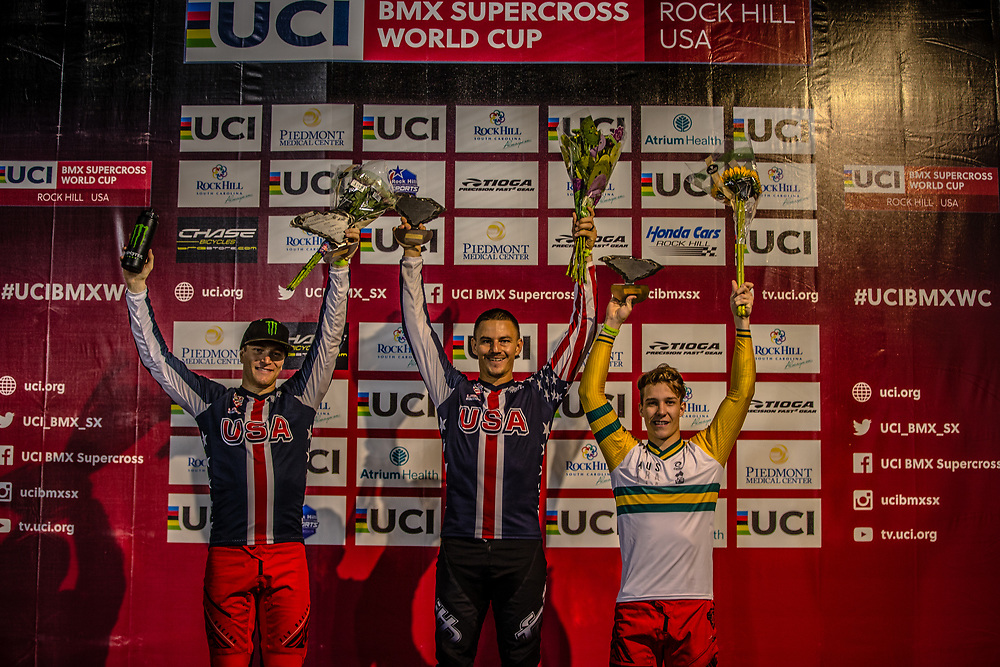 Mens Podium: 2nd: #11 (FIELDS Connor) USA [Chase, Shimano, Monster]; 1st #24 (SHARRAH Corben) USA [Daylight, Faith, Avian] 3rd #102 (KENNEDY Izaac) AUS [Chase] at Round 7 of the 2019 UCI BMX Supercross World Cup in Rock Hill, USA