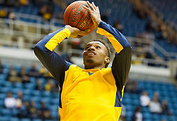 Nov 20, 2015; Morgantown, WV, USA; West Virginia Mountaineers guard Daxter Miles Jr. warms up before their game against the Stetson Hatters at WVU Coliseum. Mandatory Credit: Ben Queen-USA TODAY Sports