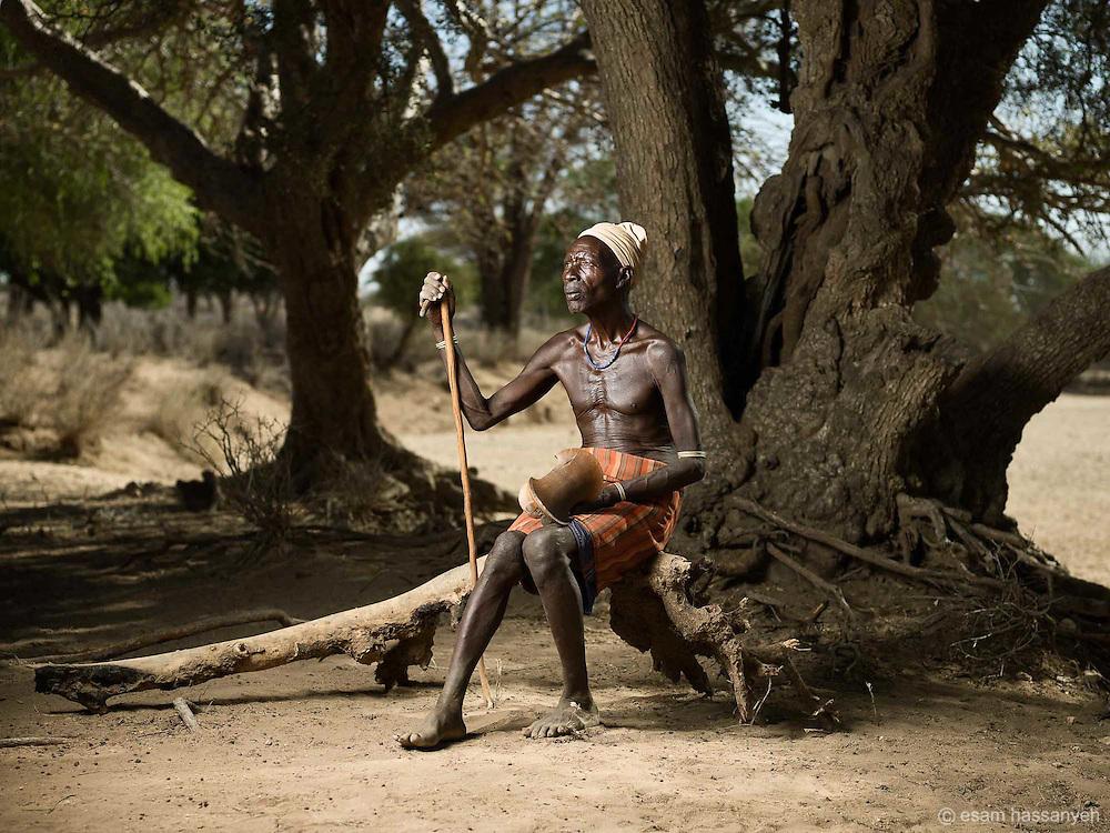 A village elder poses for a portrait, Lower Omo Valley Ethiopia.