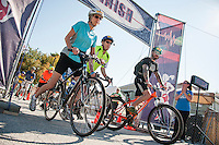 Leading out from Laconia Athletic and Swim Club are Nancy Matteson, Jim Lerner and Travis Witham-Dey for the Bike the Bay during Saturday's WOW Fest activities.  (Karen Bobotas/for the Laconia Daily Sun)