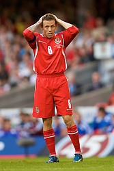 CARDIFF, WALES - Saturday, October 11, 2008: Wales' captain Craig Bellamy looks dejected after missing a chance against Liechtenstein during the 2010 FIFA World Cup South Africa Qualifying Group 4 match at the Millennium Stadium. (Photo by David Rawcliffe/Propaganda)