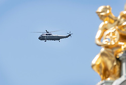 © Licensed to London News Pictures. 03/06/2019. London, UK. Marine One Presidential helicopter flies past Queen Victoria Memorial as it arrives at Buckingham Palace where President Donald Trump will meet with members of the Royal Family during his State Visit to the United Kingdom. During his three days in the UK he will meet with members of the Royal family and outgoing Prime Minister Theresa May before attending 75th Anniversary of D-Day commemorations in Portsmouth and France. Photo credit: Peter Macdiarmid/LNP