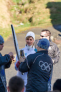 Coleen Christie's torch prepared for lighting during the 2010 Olympic Winter Games Torch Relay.  Photographed in Langley (Aldergrove), British Columbia, Canada.