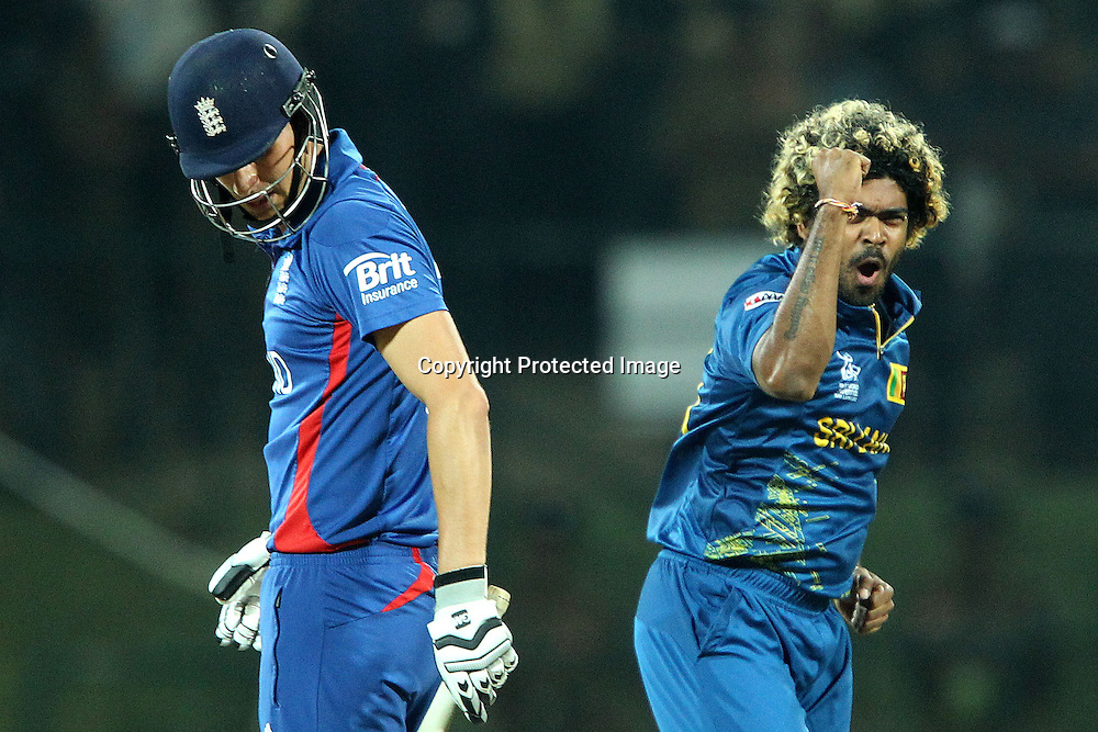 Lasith Malinga celebrates the wicket of Alex Hales of England  during the ICC World Twenty20 Super Eights match between England and Sri Lanka held at the  Pallekele Stadium in Kandy, Sri Lanka on the 1st October 2012<br /> <br /> Photo by Ron Gaunt/SPORTZPICS