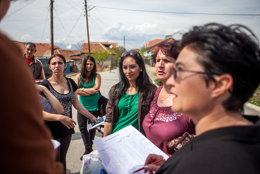 Romina Kajtazova - working as a paralegal for NGO Kham (green shirt in the back) - and co workers of the immunization project signing up participants of the local Roma community for a hand out of hygienic goods during the European Immunization Week in the city of Vinica in Macedonia. One of them is Suada - mother of a nine moths old baby (3rd from the right).