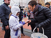 28 NOVEMBER 2019 - DES MOINES, IOWA: US Senator KAMALA HARRIS (D-CA) hugs a girl in the finish area of the Turkey Trot. The Turkey Trot is an annual Des Moines Thanksgiving Day 5 mile fun run. Sen. Harris greeted runners in the finish area and handed out cookies. She is running to be the Democratic nominee for the US Presidency in 2020. Iowa hosts the first selection event of the presidential election season. The Iowa caucuses are February 3, 2020.            PHOTO BY JACK KURTZ
