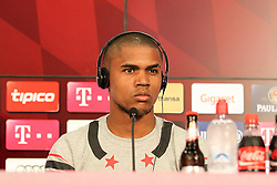 11.07.2015, Alianz Arena, Muenchen, GER, 1. FBL, FC Bayern Muenchen, Teampräsentation, Pressekonferenz, im Bild Douglas Costa #11 (FC Bayern Muenchen) bei der Pressekonferenz // during press conference for the Teampresentation of German Bundesliga Club FC Bayern Munich at the Alianz Arena in Muenchen, Germany on 2015/07/11. EXPA Pictures © 2015, PhotoCredit: EXPA/ Eibner-Pressefoto/ Kolbert<br /> <br /> *****ATTENTION - OUT of GER*****