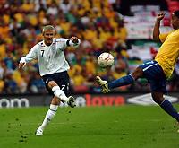 Photo: Tony Oudot.<br /> England v Brazil. International Friendly. 01/06/2007.<br /> David Beckham of England gets a shot in past Ronaldinho of Brazil