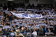 Melbourne Victory fans hold up scarves at the Hyundai A-League Round 1 soccer match between Melbourne Victory and Melbourne City FC at Marvel Stadium in Melbourne.
