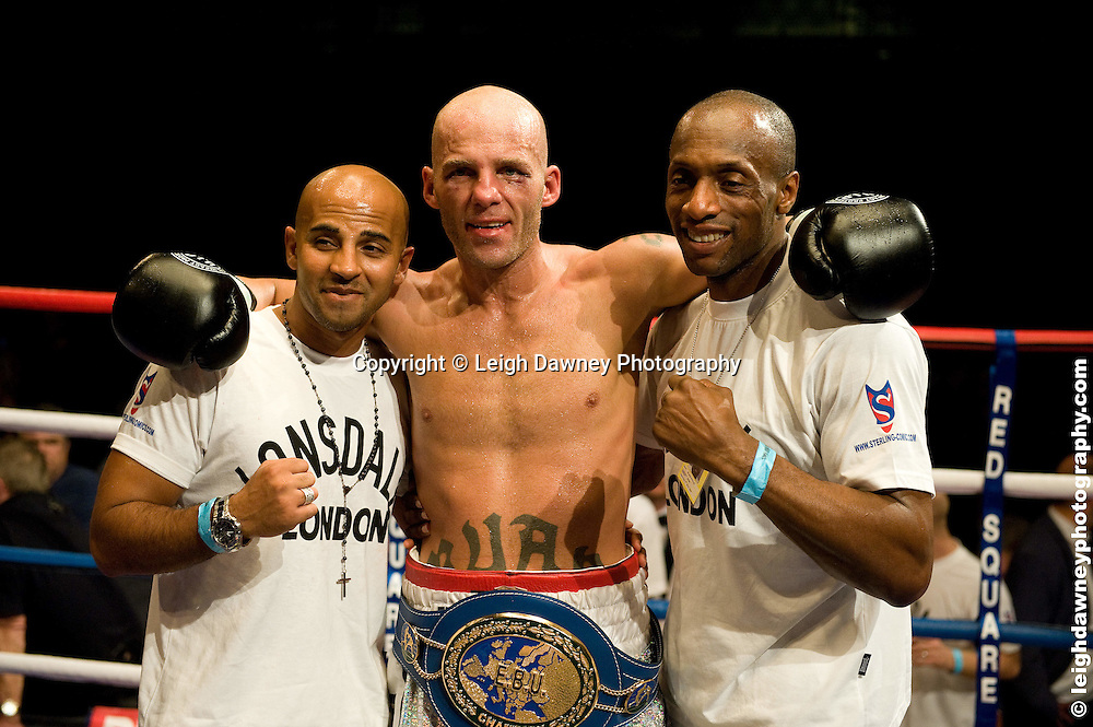 Ryan Rhodes (silver shorts) defeats Jamie Moore for the EBU Light Middleweight Title at the Bolton Arena, Bolton, UK on 23rd September 2009. Frank Maloney Promotions. photo credit © Leigh Dawney