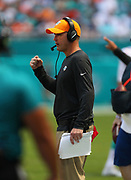 Sep 23, 2018; Miami Gardens, FL, USA; Miami Dolphins head coach Darren Rizzi pumps his fist after a play at Hard Rock Stadium against the Oakland Raiders. The Dolphins defeated the Raiders 28-20. (Steve Jacobson/Image of Sport)