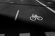 Sao Paulo, Brazil, Thursday - March 08, 2012: Bike route signal painted on Paulista avenue's pavement by bike activist.  (photo: Caio Guatelli)