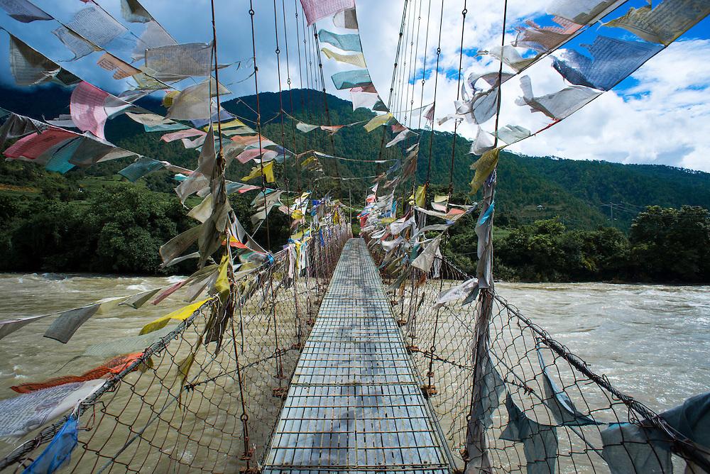 Prayer flags on a bridge in Punakha, Bhutan<br /> <br /> Full photoessay at http://xpatmatt.com/photos/bhutan-photos/