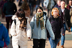 Edinburgh, Scotland, UK. 16 March, 2020. Effects of Coronavirus in Edinburgh City Centre today. Asian women covering faces with scarves on Princes Street.  Iain Masterton/ Alamy Live News