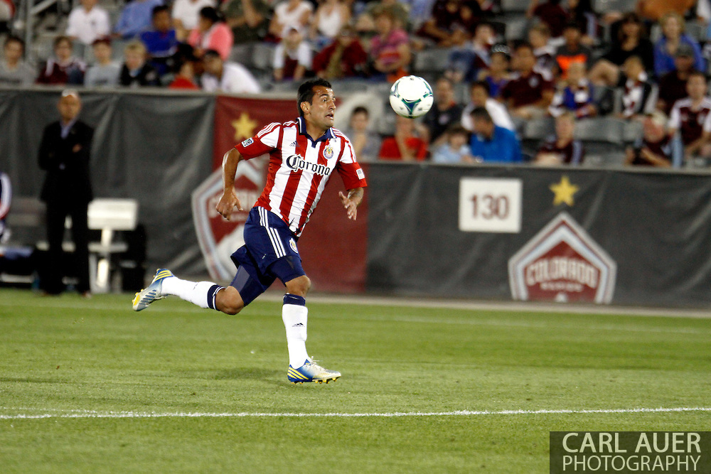 May 25th, 2013 Commerce City, CO - Chivas USA forward Jose Manuel Rivera (6) chases down a pass in the second half of the MLS match between Chivas USA and the Colorado Rapids at Dick's Sporting Goods Park in Commerce City, CO