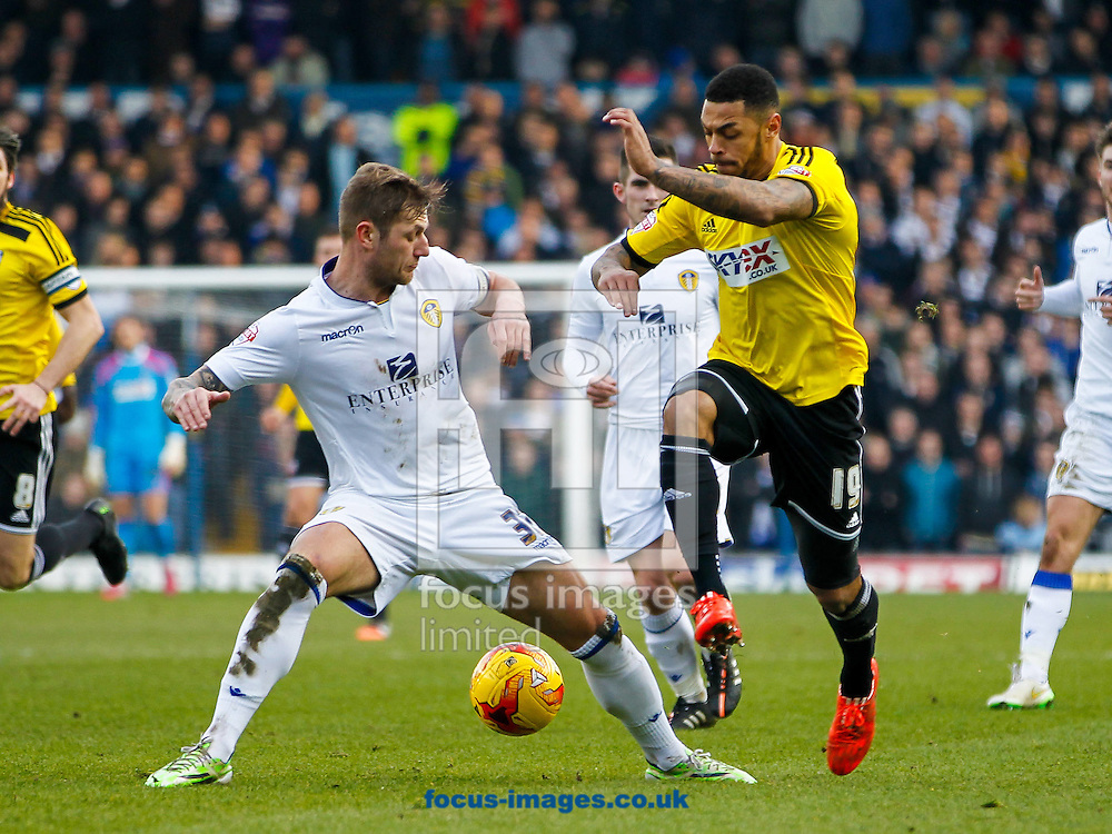 Liam Cooper of Leeds United and Andre Gray of Brentford during the Sky Bet Championship match between Leeds United and Brentford at Elland Road, Leeds<br /> Picture by Mark D Fuller/Focus Images Ltd +44 7774 216216<br /> 07/02/2015
