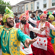 Traditional Punjabi dancers during the street party to celebrate the Royal wedding. Near the former home to Kate Middleton's Grandmother, the local community came out in their thousands to celebrate in Punjabi style, Clarence Street, Southall.
