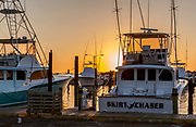NC00737-00...NORTH CAROLINA - Boats in the Oregon Inlet Marina at sunrise, Bodie Island, Cape Hatteras National Seashore.