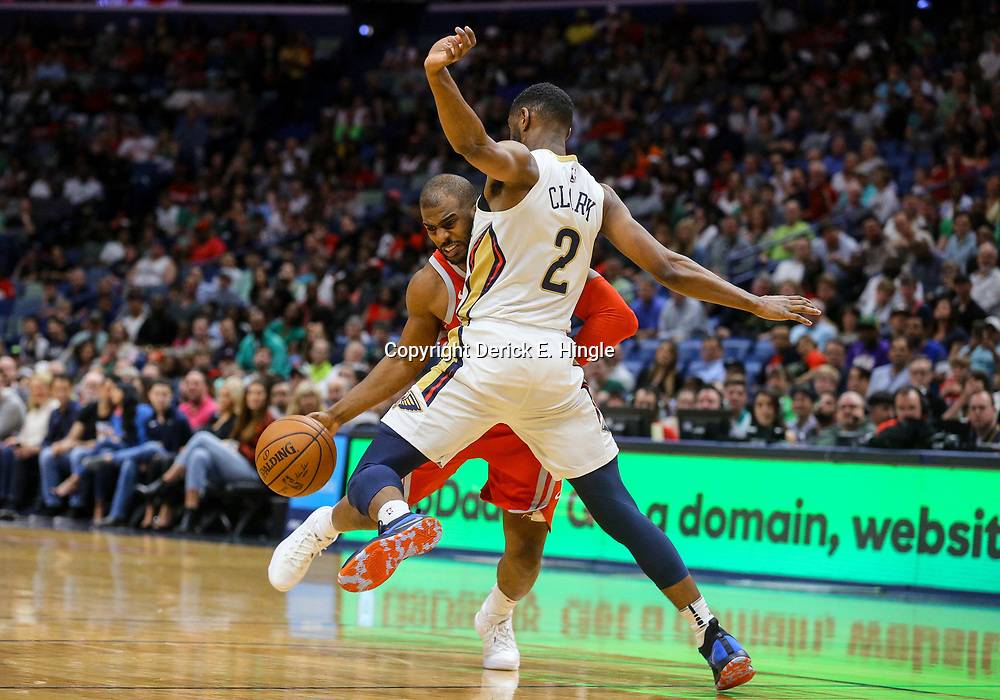 Mar 17, 2018; New Orleans, LA, USA; Houston Rockets guard Chris Paul (3) draws a foul from New Orleans Pelicans guard Ian Clark (2) during the first quarter at the Smoothie King Center. Mandatory Credit: Derick E. Hingle-USA TODAY Sports
