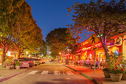 United States, Washington, Kirkland, street with shops and restaurants, lit at dusk