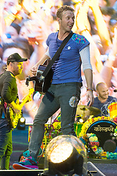 © Licensed to London News Pictures. 15/06/2016.  Coldplay member CHRIS MARTIN plays at Wembley Stadium during their Handful of Dreams World tour.<br /> <br /> Please note this supplied photo is for editorial usage only and cannot be used for merchandise.  This supplied photo must be deleted and withdraw from usage on 14th September 2016 as agreed by Coldplay management.  London, UK. Photo credit: Ray Tang/LNP