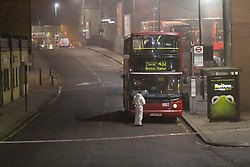 © Licensed to London News Pictures. 02/03/2012. London, UK. Scene of crime investigators searching the top deck of the 432 bus where a 17 year old male was stabbed today (02/03) outside West Norwood Bus Garage at approximately 1315hrs. London Ambulance Service and the London Air Ambulance responded and the victim was taken to a south london hospital where his wounds are said to be 'life threatening', one person  is in custody according to a Met Police spokesman.   Photo credit : James Gourley/LNP