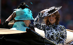 Princess Eugenie of York (right), Anne Princess Royal (left) and Princess Beatrice of York (hidden) arriving at the racecourse during day three of Royal Ascot at Ascot Racecourse.