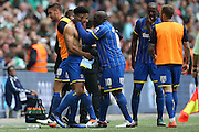AFC Wimbledon striker Lyle Taylor (33) scores the first goal of the game and celebrates during the Sky Bet League 2 play off final match between AFC Wimbledon and Plymouth Argyle at Wembley Stadium, London, England on 30 May 2016.