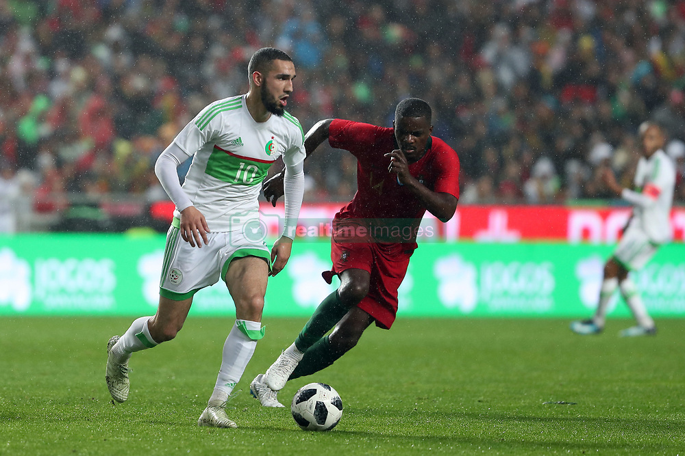 June 7, 2018 - Lisbon, Portugal - Algerias midfielder Nabil Bentaleb (L) vies with Portugal's midfielder William Carvalho during the FIFA World Cup Russia 2018 preparation football match Portugal vs Algeria, at the Luz stadium in Lisbon, Portugal, on June 7, 2018. (Portugal won 3-0) (Credit Image: © Pedro Fiuza/NurPhoto via ZUMA Press)
