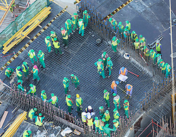 Workers on construction site of apartment skyscraper tower in Dubai United Arab Emirates