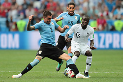 July 6, 2018 - Nizhny Novgorod, U.S. - NIZHNY NOVGOROD, RUSSIA - JULY 06: defender Jose Gimenez of Uruguay in action with midfielder N'Golo Kante of France during the Quarter-Final match between Uruguay and France in the 2018 FIFA World Cup on July 6, 2018, at Nizhny Novgorod Stadium in Nizhny Novgorod, Russia. (Photo by Anatoliy Medved/Icon Sportswire) (Credit Image: © Anatoliy Medved/Icon SMI via ZUMA Press)