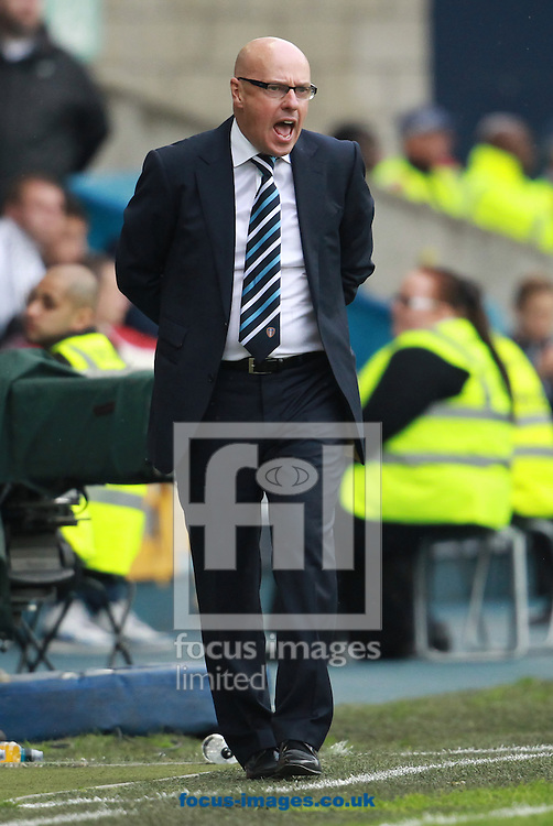 Picture by John Rainford/Focus Images Ltd +44 7506 538356<br /> 28/09/2013<br /> Manager Brian McDermott of Leeds United during the Sky Bet Championship match at The Den, London.